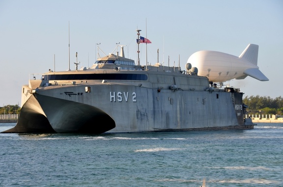 The High-Speed Vessel Swift (HSV-2) gets underway with a tethered TIF-25K Aerostat balloon in Key West, Fla., on April 24, 2013